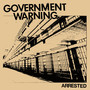 Government Warning Arrested